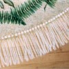 Photo of hand painted fringe on floor rug.