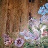 Photo of hand painted flowers on floor.