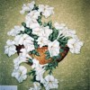 photo of a hand painted wall pocket full of petunias