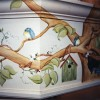 photo of mural for kitchen of birds, birdhouses and tree branches.